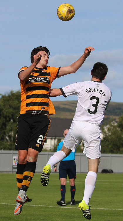 Kyle McAusland clears the pressure from Docherty  during the Dumbarton FC v Alloa FC Scottish Championship 5th September 2015 <br /> <br /> (c) Andy Scott | SportPix.org.uk