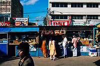 Jaffna, Sri Lanka -- February 9, 2018: Crowds in the late afternoon at the central market in downtown Jaffna.