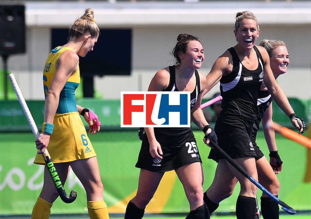 New Zealand's Kelsey Smith (C) celebrates a goal during the women's quarterfinal field hockey New Zealand vs Australia match of the Rio 2016 Olympics Games at the Olympic Hockey Centre in Rio de Janeiro on August 15, 2016. / AFP / Carl DE SOUZA        (Photo credit should read CARL DE SOUZA/AFP/Getty Images)