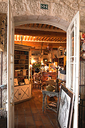 Entrance to the Pierre Laudoueneix Antiquites shop at the l'hotel Dongier in L'Isle-sur-la-Sorgue in Provence, Southern France. Known for its twice a week markets and numerous antique and design shops, this busy market town is high on the must-see list of visitors to Provence.