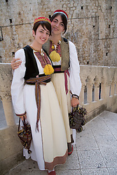 Europe, Croatia, Dalmatia, Dubrovnik. Young women in traditional clothing.  The historic center of Dubrovnik is a UNESCO World Heritage site.  MR