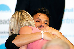 "Peter Andre hugs a fan during a book signing event to promote his new childrens books ""The Happy Birthday Party"" and ""A New Day at School"" in WH Smiths Sheffield on 6th September2011 Image © Paul David Drabble"