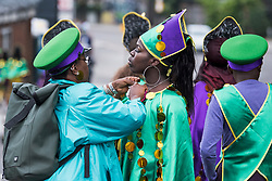 © Licensed to London News Pictures. 26/08/2018. London, UK. Carnival goers make last minute alterations to costumes at family day of the 2018 Notting Hill Carnival. Up to 1 million people are expected to attend this weekend's event that is one of the worlds largest street festivals. Photo credit: Ben Cawthra/LNP