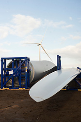 Ulley Wind Farm At £95,000 pounds each, three turbine blades wait to be fitted to the hub before the assembled pieces can be hoisted up and fitted to the nacelle..13  March  2013.Image © Paul David Drabble