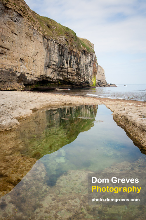 Swimming pool blasted out of the rock at Dancing Ledge on the Isle of Purbeck, Dorset, UK