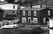 Pope John Paul II is greeted by a family as he passes their house while arriving to bless the fishing fleet in Flat Rock, Nfld. (1984)