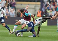 Football - 2017 / 2018 Premier League - West Ham United vs Tottenham Hotspur<br /> <br /> Javier (Chicharito) Hernandez (West Ham United)  and Moussa Sissoko (Tottenham FC) battle for the ball at the London Stadium<br /> <br /> COLORSPORT/DANIEL BEARHAM