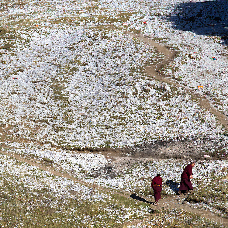 Monks walk on the hill covered with buddhism prayer papers near Kirti monastery in Langmusi, Gansu Province, Tibetan part of China on Oct 13, 2015. <br /> (Photo by Kuni Takahashi)