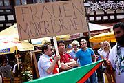 Frankfurt am Main | 26 July 2014<br /> <br /> Am Samstag (26.07.2014) demonstrierten etwa 500 Menschen auf dem R&ouml;merberg in Frankfurt am Main f&uuml;r Frieden in Pal&auml;stina / Gaza und f&uuml;r ein sofortiges Ende der israelischen Milit&auml;reins&auml;tze dort.<br /> Hier: Einige Teilnehmer der Demo f&uuml;hrten Transparente mit offen israelfeindlichen Spr&uuml;chen mit, hier z.B. &quot;Frauenm&ouml;rder Israel&quot;.<br /> <br /> &copy;peter-juelich.com<br /> <br /> FOTO HONORARPFLICHTIG!<br /> <br /> [No Model Release | No Property Release]