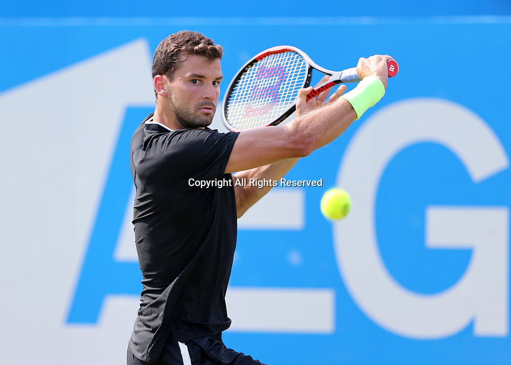 June 21st 2017, Queens Club, West Kensington, London; Aegon Tennis Championships, Day 3; Grigor Dimitrov of Bulgaria plays a backhand to Julien Benneteau of France