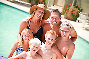 Happy Family Together in the Pool on Vacation