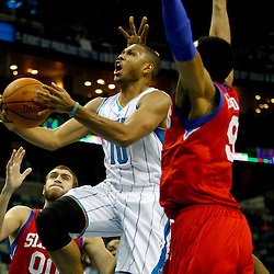 January 4, 2012; New Orleans, LA, USA; New Orleans Hornets shooting guard Eric Gordon (10) shoots over Philadelphia 76ers small forward Andre Iguodala (9) during the first quarter of a game at the New Orleans Arena.   Mandatory Credit: Derick E. Hingle-US PRESSWIRE