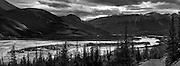 Black and white photograph of Jasper lake and surrounding mountains from the other side of Jasper Lake, Jasper National Park, Alberta, Canada