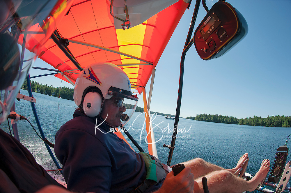 Keith Markley readies for takeoff in his two seater Quicksilver Seaplane from Center Harbor Bay on Friday morning.  (Karen Bobotas/for the Laconia Daily Sun)
