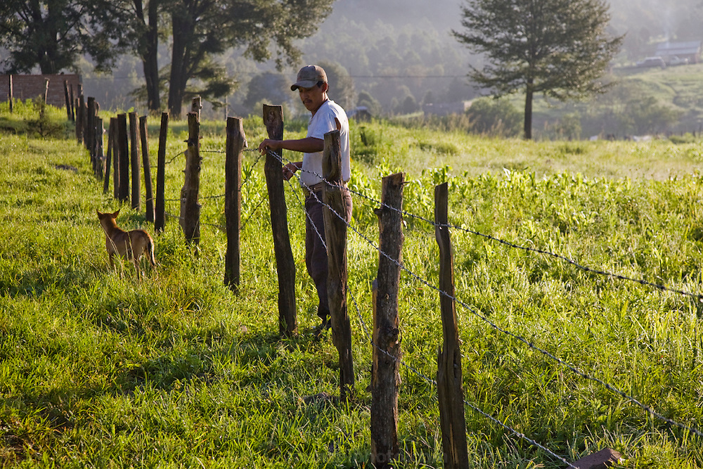 Rancher José Angel Galaviz repairs fences with his 22 year old nephew, Rigoberto, at his home in the Sierra Mountains  near Maycoba, in the Mexican state of Sonora.  (José Angel Galaviz Carrillo is featured in the book What I Eat: Around the World in 80 Diets.)