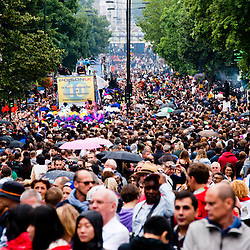 London, UK - 27 August 2012: crowded street during the parade of the annual Notting Hill Carnival.