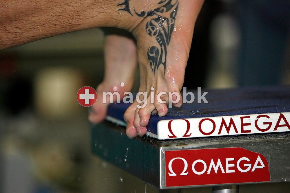 Swimmers feet on the starting block are pictured during a practice session in the Schwimm- und Sprunghalle Europa Sportpark one day prior to the start of the Fina Swimming World Cup in Berlin, Germany, Friday 16 November 2007. (Photo by Patrick B. Kraemer / MAGICPBK)