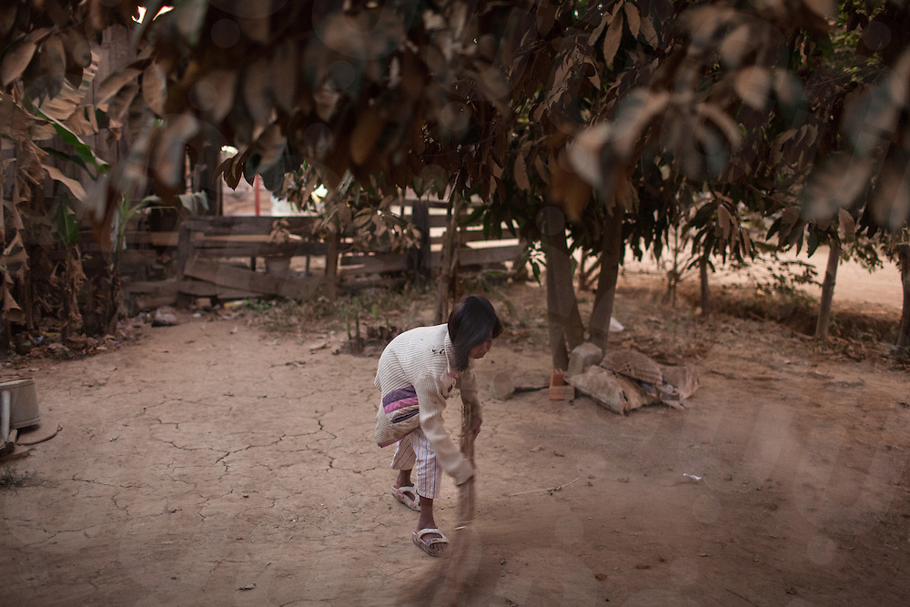 T. works on her days off from school on the sugar plantation to help her parents earn enough money to live. Omlaing, Kampong Speu, Cambodia. 17 Feb. 2013. © Nicolas Axelrod / Ruom