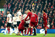 Manchester United midfielder Nemanja Matic (31) is shown a yellow card by Referee Craig Pawson for the foul on Liverpool midfielder Georginio Wijnaldum (5) during the Premier League match between Liverpool and Manchester United at Anfield, Liverpool, England on 19 January 2020.