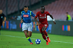 NAPLES, ITALY - Wednesday, October 3, 2018: Liverpool's Sadio Mane (R) is chased by Napoli's Allan Marques Loureiro during the UEFA Champions League Group C match between S.S.C. Napoli and Liverpool FC at Stadio San Paolo. (Pic by David Rawcliffe/Propaganda)