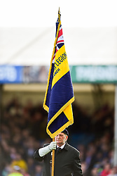 The Flag Bearer raises the flag during the Remembrance Ceremony prior to kick off - Mandatory by-line: Ryan Hiscott/JMP - 10/11/2018 - RUGBY - Sandy Park Stadium - Exeter, England - Exeter Chiefs v Harlequins - Premiership Rugby Cup