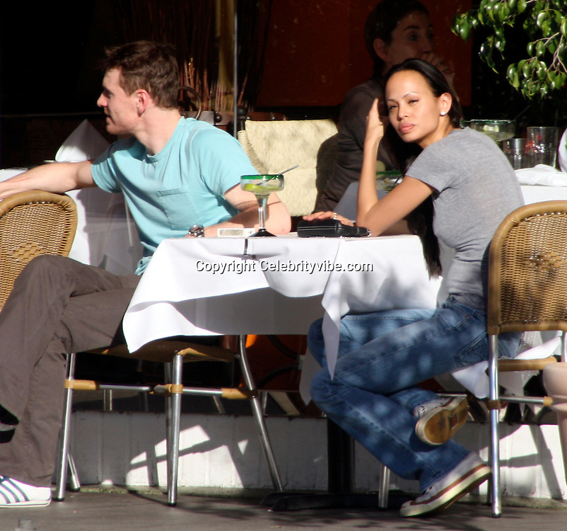 **EXCLUSIVE**.Michael Fassbender with girlfriend Leasi Andrews..Eating lunch and drinking margaritas..Fajita Mexican Restaurant..Beverly Hills, CA, USA..Friday, December 05, 2008..Photo By Celebrityvibe.com.To license this image please call (212) 410 5354; or Email: celebrityvibe@gmail.com ;.website: www.celebrityvibe.com