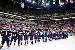 Players of USA listening to the national anthem after winning during Ice Hockey match between USA and Czech Republic at Third place game of 2015 IIHF World Championship, on May 17, 2015 in O2 Arena, Prague, Czech Republic. Photo by Vid Ponikvar / Sportida