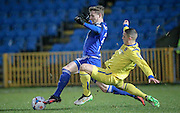 Oliver Norburn (Guiseley) about to tackle Kieran Sadler (Halifax) during the Conference Premier League match between FC Halifax Town and Guiseley at the Shay, Halifax, United Kingdom on 5 December 2015. Photo by Mark P Doherty.