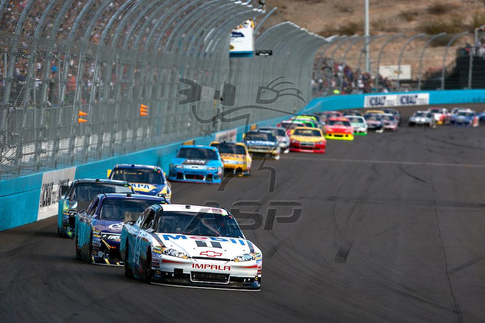 Avondale, AZ - NOV 13, 2011:  Tony Stewart (14) races for the Kobalt Tools 500 race at the Phoenix International Raceway in Avondale, AZ.