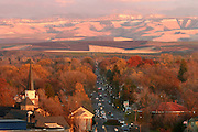 AUTUMN'S SPLENDOR -- Autumn's splendor slips down Alder Street on a late November evening, pausing for a brief moment in the rooftops and treetops of town before vanishing into the wintry Blues.        Walla Walla, WA    (11/18/04)    Matthew B Zimmerman Photo Scenic image from the Walla Walla Valley. Fall color and leaves, spring flowers, winter snow, and summer sun.