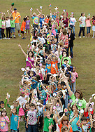 About 590 students and staff from Hamilton Bicentennial Elementary School formed a giant peace sign behind the school in Cuddebackville to celebrate International Peace Day on Friday, Sept. 21, 2012. As participants in the Pinwheels for Peace Project, the students in kindergarten through sixth grade held pinwheels they made as part of their school's character education program.