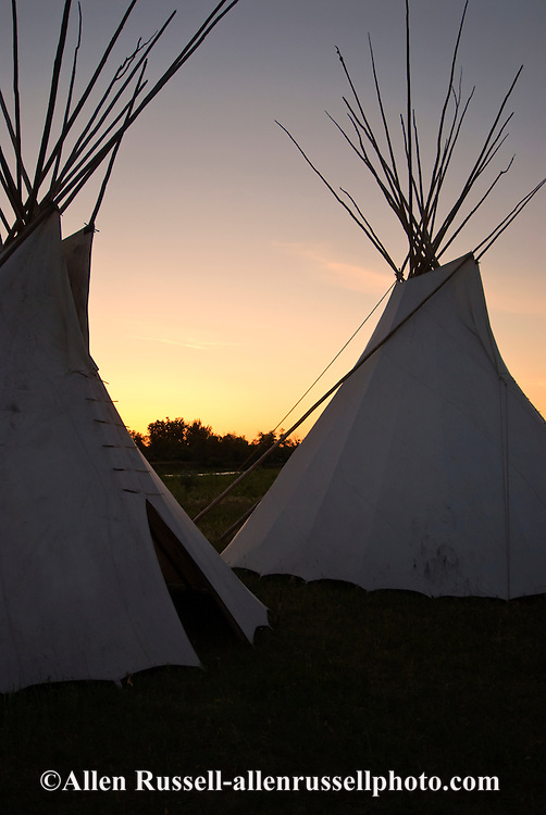 Tipis on banks of Little Bighorn River, Crow Indian Reservation, Montana, sunset