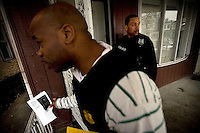Philadelphia Police Detectives Robert Richardson, left, and Robert Penn try to serve a warrant in South Philadelphia on Friday, Feb. 3, 2006. Photo by Ryan Donnell