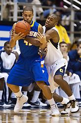 December 29, 2009; Berkeley, CA, USA;  UC Santa Barbara Gauchos guard James Powell (42) is fouled by California Golden Bears guard Patrick Christopher (23) during the first half at Haas Pavilion.  California defeated UC Santa Barbara 87-66.