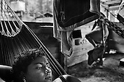 French Guiana, Ibiza, Ipoussing.<br /> <br /> Concession miniere, &quot;garota de programa&quot;.<br /> L'economie de nombreuses colonies de l'Amazonie bresilienne d&eacute;pend de l'activite aurifere et de ses m&eacute;tiers derives. Pendant que les hommes partent faire les garimpeiros sur les chantiers guyanais, les femmes vont faire des programmes en foret.<br /> Elles font la tournee des sites miniers pour rejoindre des clients qu'elles accompagnent quelques jours, en fonction de la production d'or.