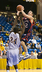 November 30, 2009; San Jose, CA, USA;  Saint Mary's Gaels guard Mickey McConnell (32) shoots over San Jose State Spartans guard Chris Jones (24) during the first half at the Event Center Arena.  Saint Mary's defeated San Jose State 78-71.