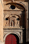 Detail of side door, Old Cathedral, Salamanca, Spain, pictured on December 19, 2010. Above the Romanesque door is a sculpture of the Virgin Mary in a Classical style niche. Salamanca, Spain's most important University city,  has two adjoining Cathedrals, Old and New. The old Romanesque Cathedral was begun in the 12th century, and the new in the 16th century. Its style was designed to be Gothic rather than Renaissance in keeping with its older neighbour, but building continued over several centuries and a Baroque cupola was added in the 18th century. Restoration was necessary after the great Lisbon earthquake, 1755. Picture by Manuel Cohen