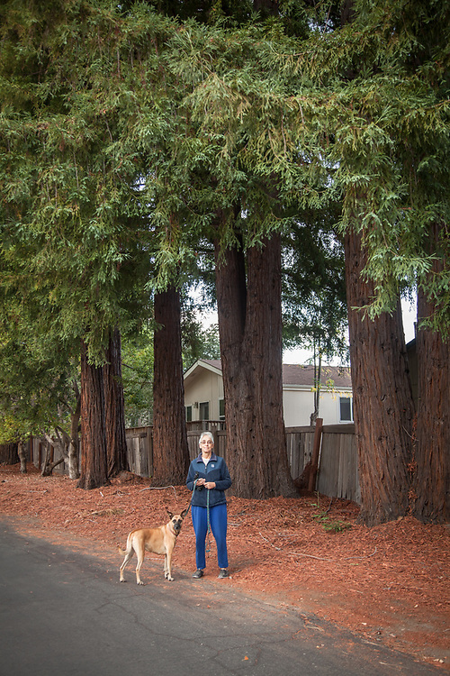 "Lucie Erwin with her dog, Sierra, Rancho de Calistoga. ""I live in the trailer park...I like the big trees but the management dosen't like anyone to bend the rules...I'm selling my home...it's too close to the highway.""   erwinlucy@yahoo.com"