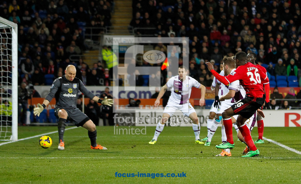 Wifried Zaha of Cardiff City scores a disallowed goal against Aston Villa during the Barclays Premier League match at the Cardiff City Stadium, Cardiff<br /> Picture by Mike  Griffiths/Focus Images Ltd +44 7766 223933<br /> 11/02/2014