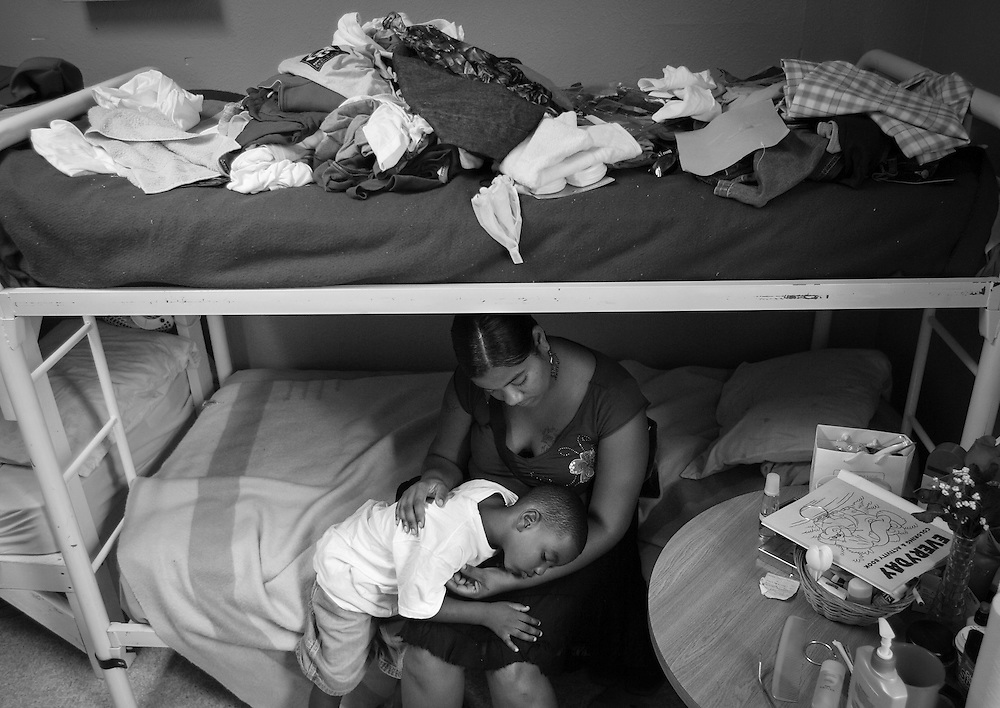 LOS ANGELES, CA - September 9, 2005:  Allison Caesh and her son Randy, 4, spend time in their room crowded with donated items at the Dream Center, a shelter for Hurricane Katrina evacuees in Los Angeles, California on September 9, 2005. (Photo by Todd Bigelow/Aurora)..