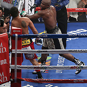 LAS VEGAS, NV - SEPTEMBER 13: Floyd Mayweather Jr. (R) hits Marcos Maidana with a left hook during their WBC/WBA welterweight title fight at the MGM Grand Garden Arena on September 13, 2014 in Las Vegas, Nevada. (Photo by Alex Menendez/Getty Images) *** Local Caption *** Floyd Mayweather Jr; Marcos Maidana