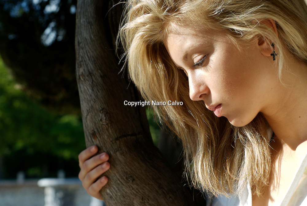 MR Attractive young blonde woman posing in nature