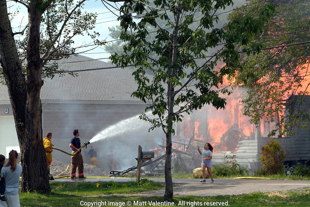A home burns in Cleveland, 2004.