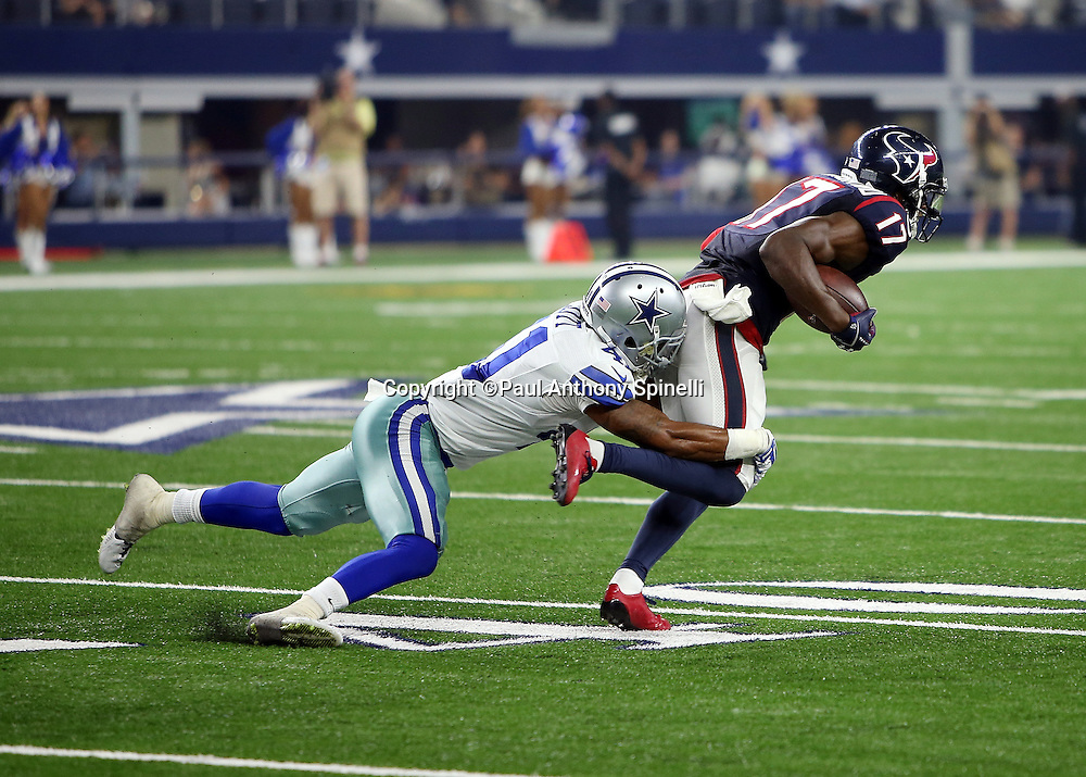 Houston Texans wide receiver Uzoma Nwachukwu (17) breaks away from a tackle attempt by Dallas Cowboys rookie defensive back Tim Scott (41) as he catches a fourth quarter pass for a gain of 15 yards and a first down during the 2015 NFL preseason football game against the Dallas Cowboys on Thursday, Sept. 3, 2015 in Arlington, Texas. The Cowboys won the game 21-14. (©Paul Anthony Spinelli)