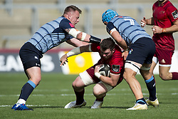September 30, 2017 - Limerick, Ireland - Peter O'Mahony of Munster tackled by Matthew Rees and Olly Robinson of Cardiff during the Guinness PRO14 Conference A Round 5 match between Munster Rugby and Cardiff Blues at Thomond Park in Limerick, Ireland on September 30, 2017  (Credit Image: © Andrew Surma/NurPhoto via ZUMA Press)