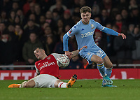 Football - 2019 /2020 FA Cup - Third Round: Arsenal vs. Leeds United.<br /> <br /> Granit Xhaka (Arsenal FC) grabs hold of Jordan Stevens (Leeds United) after he slips on the turf at the Emirates Stadium<br /> <br /> COLORSPORT/DANIEL BEARHAM
