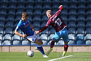 Steven Davies fouled by Neal Bishop during the EFL Sky Bet League 1 match between Rochdale and Scunthorpe United at Spotland, Rochdale, England on 12 August 2017. Photo by Daniel Youngs.