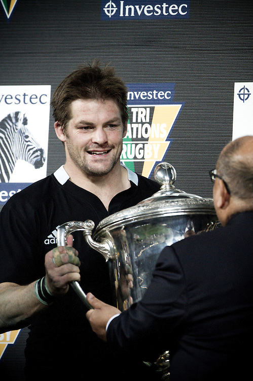 Sir Anand Satyanand presents All Blacks Captain Richie McCaw with the Bledisloe Cup following the match between the New Zealand All Blacks and Australian Wallabies at Eden Park, Auckland, New Zealand, Friday, August 6, 2011.  Credit: SNPA / Bethelle McFedries
