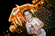 Boy with icecream outside a house with Christmas Lights. Newcastle, Australia