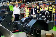 Koningin Maxima tijdens een werkbezoek aan TOBROCO Machines in Oisterwijk. De fabrikant van machines is winnaar van de Koning Willem I Prijs 2016 in de categorie midden- en kleinbedrijf.<br /> <br /> Queen Maxima during a work visit to TOBROCO Machines in Oisterwijk. The machine manufacturer is the winner of the Koning Willem I Price 2016 in the small and medium-sized category.